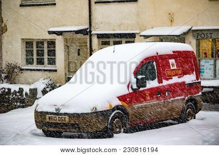 Drewsteignton, Devon, United Kingdom, 01/03/2018:- Snow Covered Royal Mail Van During The Beast From
