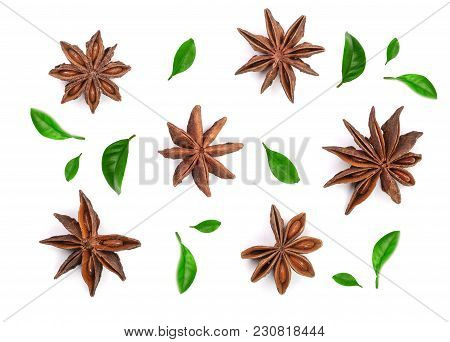 Star Anise Decorated With Leaves Isolated On White Background. Top View.