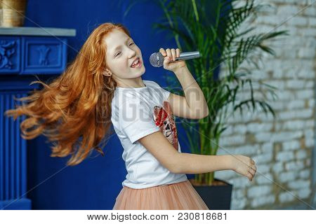 Emotional Child Sings A Song Into The Microphone. The Concept Is Childhood, Lifestyle, Music, Singin