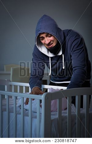 Criminal stealing baby in human child trafficking concept