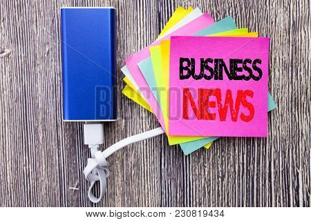 Business News. Business Concept For Modern Online News Written On Sticky Note With Space On Old Wood