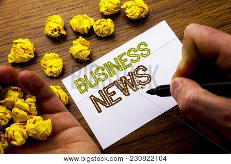 Word, Writing Business News. Concept For Modern Online News Written On Notebook Note Paper On Wooden