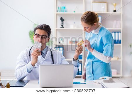 Male and female doctor having discussion in hospital