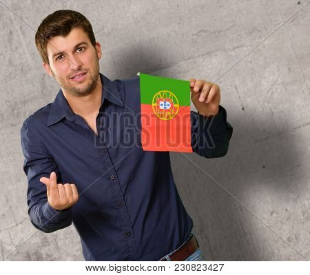 Young Man Holding Portugal Flag Gesturing, Indoor