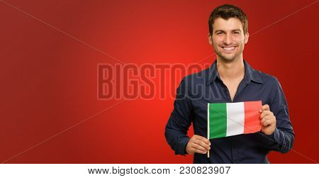 Young Happy Man Holding Irish Flag On Red Background