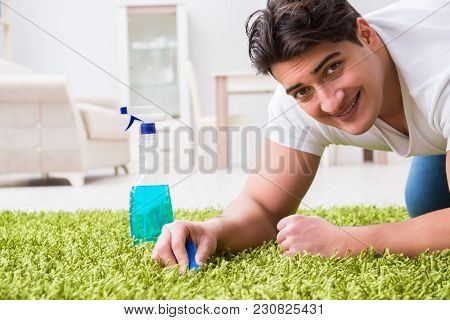 Young husband man cleaning floor at home
