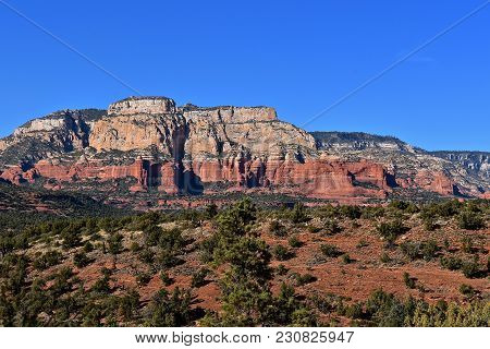 Red Rock Mountain Range Of Sedona, Arziona Against A Clear Blue Sky