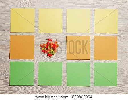 Stationary, Blank Colored Sticker, Pushpins On White Wooden Board. Top View. Flat Lay. Time-manageme