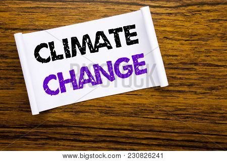 Word, Writing Climate Change. Business Concept For Global Planet Warming Written On Sticky Note Pape