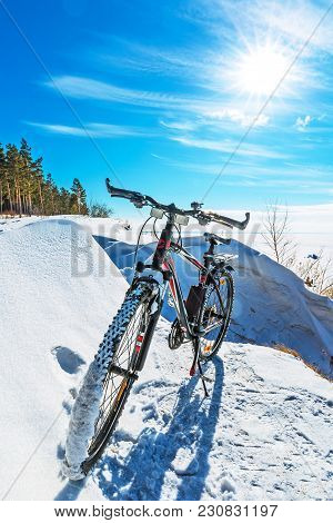 Ob River Coast, Novosibirsk Region, Western Siberia, Russia-march 10, 2018: Bicycle Off The Snow-cov