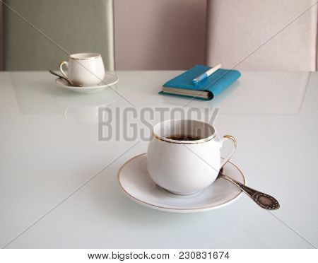 Cups Of Coffee With Espresso And Another Cup Of Coffee And Notebook In The Distance. Business Meetin