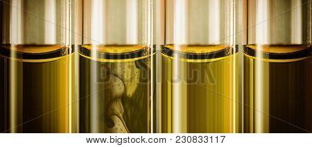 Yellow Liquid Machine Oil In Small Tubes