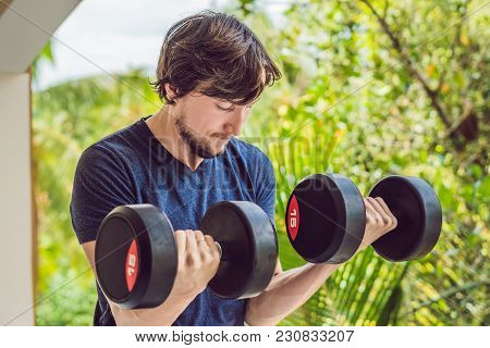 Bicep Curl - Weight Training Fitness Man Outside Working Out Arms Lifting Dumbbells Doing Biceps Cur