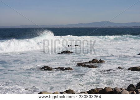 This Is An Image Of Rocks And Waives Along The Coast Of Pacific Grove, California.