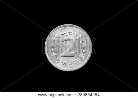 A Super Macro Image Of An Old 2 Pakistani Rupee Coin Isolated On A Black Background