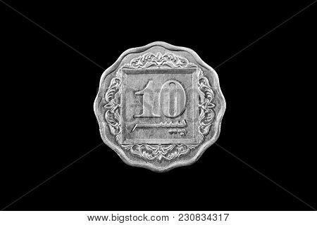 A Super Macro Image Of An Old 10 Pakistani Rupee Coin Isolated On A Black Background
