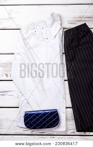 White Decorated Women Blouse And Blue Wallet. Black Striped Skirt With Pocket.
