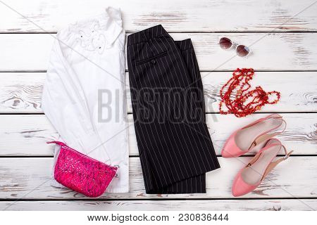 Flat Lay Feminine Autumn And Winter Clothes Collage. Pink Heel Shoes, Top View.