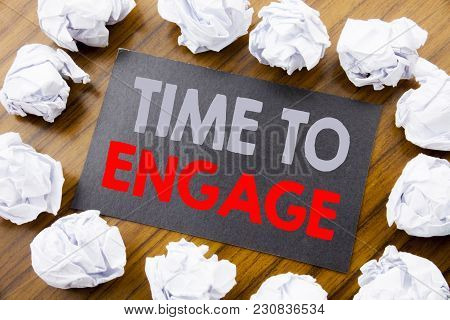 Hand Writing Text Caption Showing Time To Engage. Business Concept For Engagement Involvement Writte
