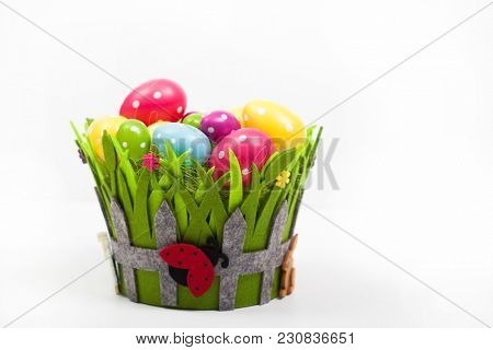 Easter background with colorful Easter eggs in basket on white background