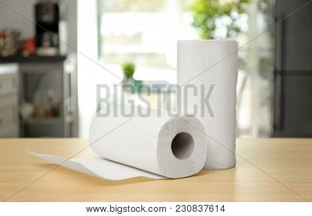 Rolls of paper towels on table indoors