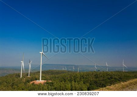 Wind Turbine Generating Electricity With Blue Sky .