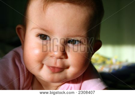 Cute Baby In The Sunlight