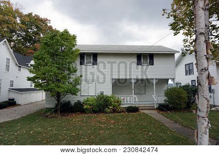 Bay View, Michigan / United States - October 16, 2017: A White Two Story Cottage, With A Front Porch
