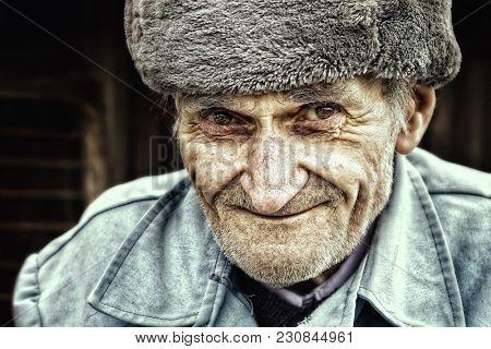Old senior man smiling for outdoor portrait. East european people