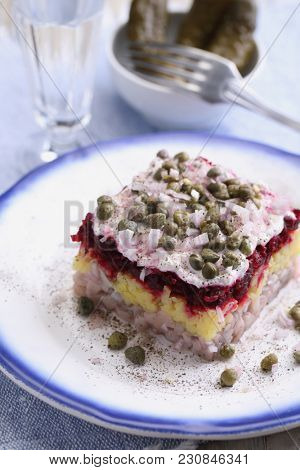 Portion of Dressed Herring salad also known as Herring Under Fur Coat