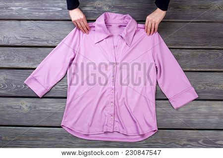 Pink Shirt And Hands, Flat Lay. Grey Wooden Surface Background.