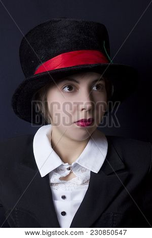 A Young Girl In A Black Velvet Hat Magician