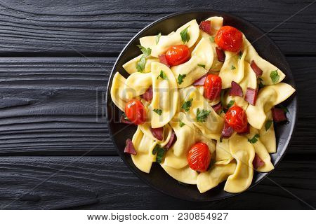 Italian Dumplings Casoncelli Stuffed With Ham With Cherry Tomatoes Close-up On A Plate. Horizontal T