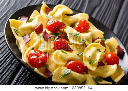Delicious Dumplings Casoncelli With Ham, Cherry Tomatoes And Greens Close-up. Horizontal