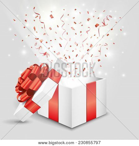 Opened Gift Box With Red Confetti And Streamer