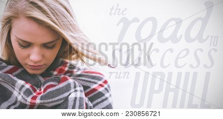 The road to success run uphill against close up of a young woman covered with blanket