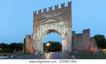 RIMINI, ITALY - JUNE 13, 2017: People resting at the Arch of Augustus. The arch was dedicated to the Emperor Augustus by the Roman Senate in 27 BC and is the oldest survived Roman arch