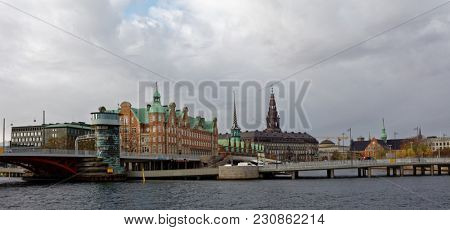 COPENHAGEN, DENMARK - NOVEMBER 7, 2016: View to Christiansborg Palace and bridges. The palace is the seat of the Danish Parliament, the Danish Prime Minister's Office and the Supreme Court of Denmark