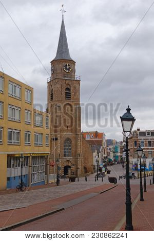 SCHEVENINGEN, THE HAGUE, NETHERLANDS - JANUARY 3, 2017: View to the Oude Kerk, Old Church on Keizerstraat. Built in the mid 15th century, the church was restored in 1957-1959