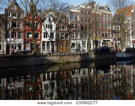 AMSTERDAM, NETHERLANDS - JANUARY 2, 2017: One of canals in the historical part of city. The 17th-century canal ring area were placed on the UNESCO World Heritage List in 2010