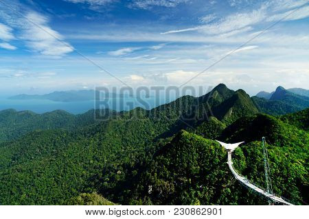 Sky Bridge and Cable Car with mountains sea and tropical forests in the background, Langkawi island, Malaysia. Langkawi SkyCab is one of the major attractions in the island