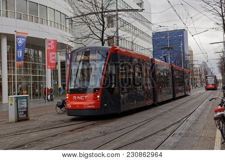 THE HAGUE, NETHERLANDS - JANUARY 3, 2017: Modern trams on line in the Hague city center. This new R-Net trams built by Siemens and is better accessible for the disabled people