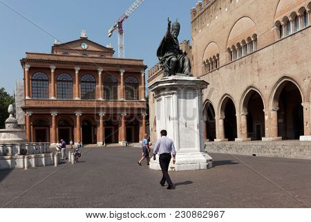 RIMINI, ITALY - JUNE 13, 2017: People on Piazza Cavour at the monument to Pope Paul V. The monument was installed here in 1614