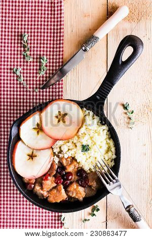 Top View Image Of Couscous With Meat Stew, Cranberry, Served With Apples
