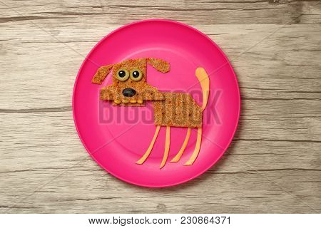 Dog Compiled With Food Ingredients On Plate And Board