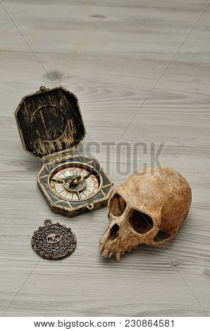 A Compass And A Pirate Coin Toy For A Pirate Game With A Monkey Skull