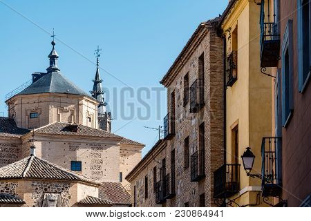 Picturesque View Of Buildings In Toledo Old Town With San Marcos Church On Background