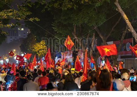 Crowd Of Vietnamese Football Fans Down The Street To Celebrate The Win After Soccer, With A Lot Of V