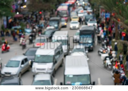 Aerial Blurred Image Of Traffic Jam In City. Urban Infrastructure Problem.