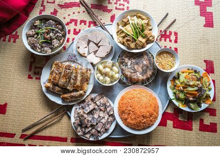 A Traditional Vietnamese Meal For Lunar New Year Tet Holiday In Spring, Placed On New Flowered Sedge